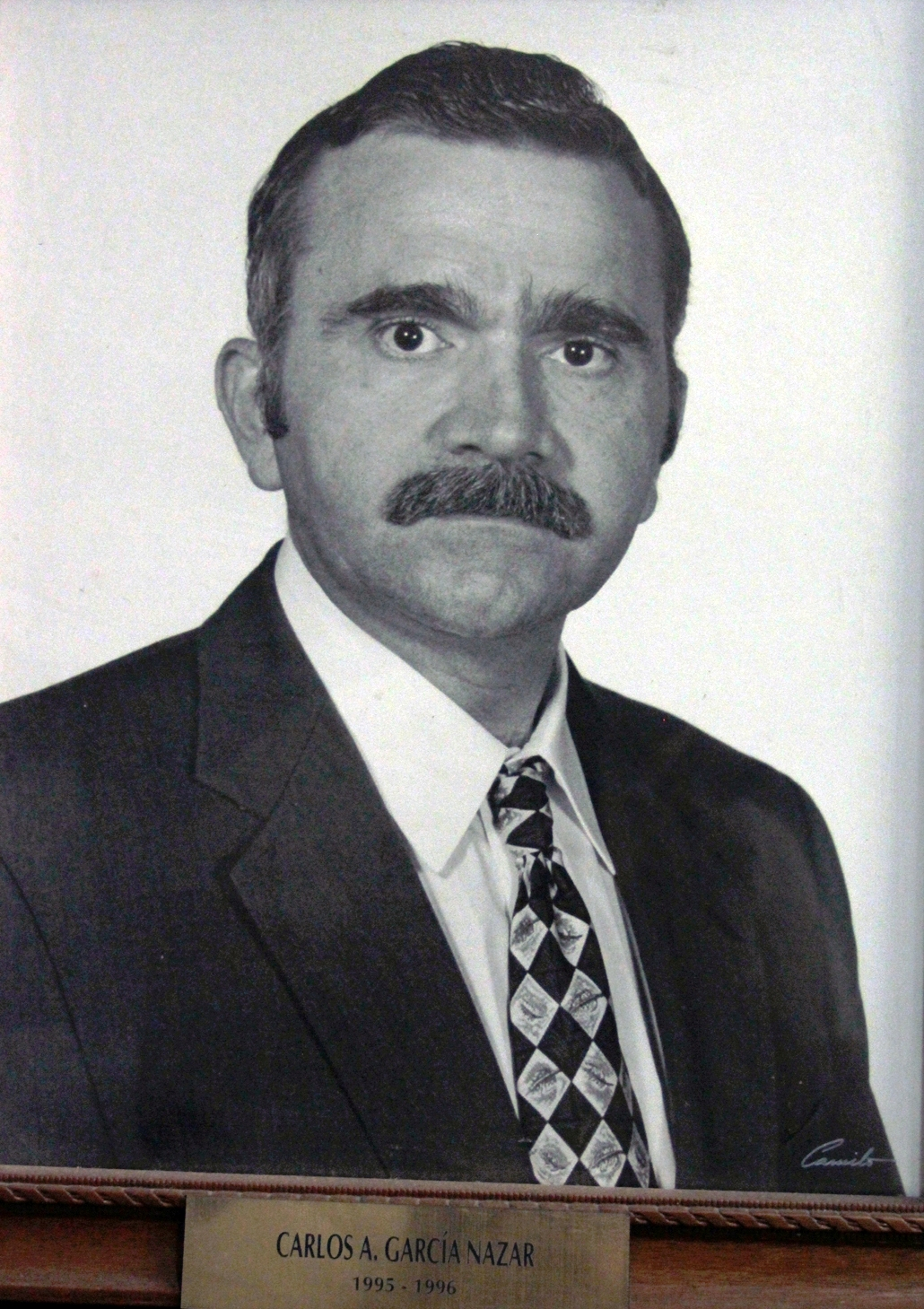EMPRESARIO DISTINGUIDO. CARLOS A. GARCIA NAZAR